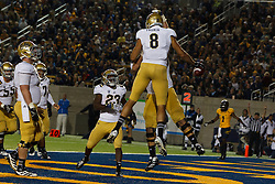 BERKELEY, CA - OCTOBER 06: Tight end Joseph Fauria #8 of the UCLA Bruins celebrates with teammates after scoring a touchdown against the California Golden Bears during the third quarter at California Memorial Stadium on October 6, 2012 in Berkeley, California. The California Golden Bears defeated the UCLA Bruins 43-17. (Photo by Jason O. Watson/Getty Images) *** Local Caption *** Joseph Fauria