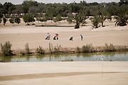 Abu Dhabi, United Arab Emirates (UAE). March 20th 2009.<br /> Al Ghazal Golf Club.<br /> 36th Abu Dhabi Men's Open Championship.<br /> H.J Kim (right)
