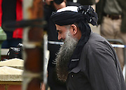 © Licensed to London News Pictures. 13/11/2012. London, UK Terror suspect Abu Qatada arrives home after he was released from jail following his dramatic victory against deportation. Photo credit : Stephen Simpson/LNP