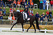 Carina Brynhildsen - Shiraz Black<br /> FEI European Dressage Championships for Young Riders and Juniors 2013<br /> © DigiShots