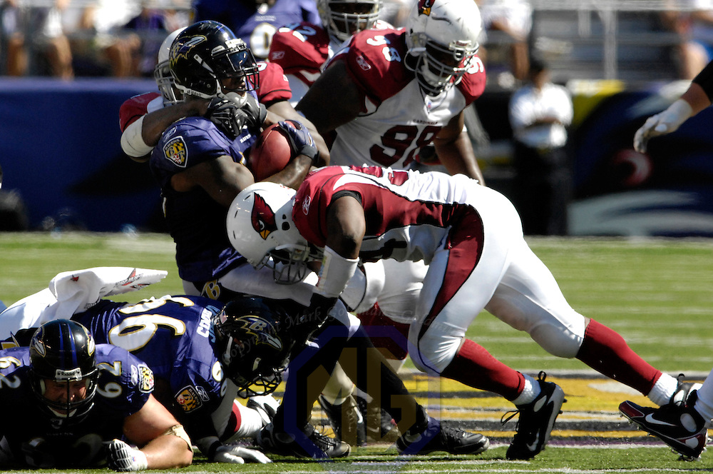 23 September 2007:  Baltimore Ravens running back Willis McGahee (23) catches a pass for a 9-yard gain in the 2nd quarter before being stopped by Arizona Cardinals defensive lineman Antonio Smith (94) and linebacker Gerald Hayes (54).  The Ravens defeated the Cardinals 26-23 on a 46 yard field goal by Matt Stover with no time remaining at M&T Bank Stadium in Baltimore, Md. .