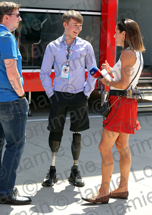 The 2018 Formula 1 F1 Rolex British grand prix, Silverstone, England. Saturday 7th July 2018.<br /> <br /> Pictured: British racing driver Billy Monger (Billy The Whizz) walks on his new prosthetics in the paddock at Silverstone.<br /> <br /> Jamie Lorriman<br /> mail@jamielorriman.co.uk<br /> www.jamielorriman.co.uk<br /> 07718 900288