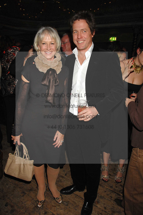 DAME HELEN MIRREN and HUGH GRANT at a reception to Discover Wilton's Music Hall held at the hall in Graces Alley, London E1 on 5th December 2007.<br />