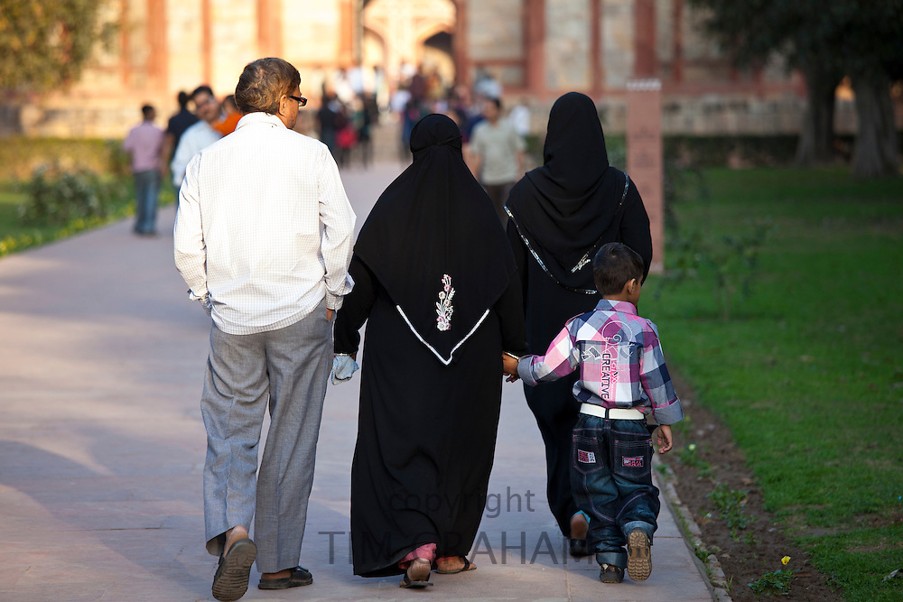 Muslim family visitors at Humayuns Tomb, World Heritage Monument built 16th Century, in New Delhi, India