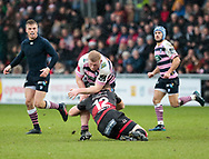 Cardiff Blues' Bradley Thyer is tackled by Dragons' Jack Dixon<br /> <br /> Photographer Simon King/Replay Images<br /> <br /> Guinness Pro14 Round 11 - Dragons v Cardiff Blues - Tuesday 26th December 2017 - Rodney Parade - Newport<br /> <br /> World Copyright &copy; 2017 Replay Images. All rights reserved. info@replayimages.co.uk - www.replayimages.co.uk