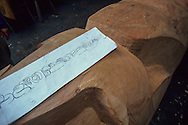 Canada. Queen Charlotte island. Skidegate village.  Wilfred Stevens, Indian  artist from Haida tribe, working on a totem    Canada   /  Wilfred Stevens, sculpteur haida, son maillet en main et son ciseau à bois. Détail du mât: la Femme-Chouette.  Skidegate  Canada