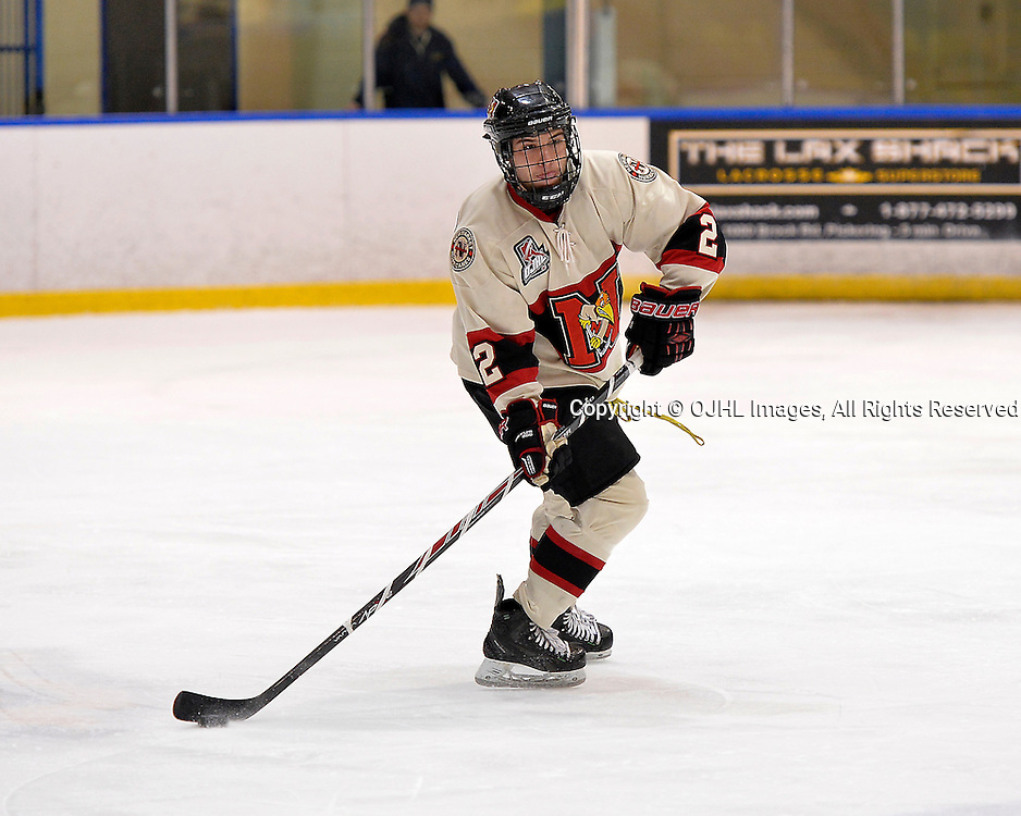 WHITBY, ON - Oct 9, 2015 : Ontario Junior Hockey League game action between Newmarket and Whitby, Nick Kalpousos #2 of the Newmarket Hurricanes passes the puck during the third period.<br /> (Photo by Shawn Muir / OJHL Images)