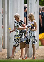 © Licensed to London News Pictures. 07/07/2015. London, UK. Family of those who lost their lives and survivors of the attack lay flower at the memorial during the service. A memorial service in Hyde Park London on the 10th anniversary of the 7/7 bombings in London. The event is attended by Prince William, survivors of the attack and family of those who lost their lives. Photo credit: Ben Cawthra/LNP