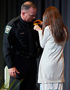 Officers who advanced in rank participated in a badge-pinning ceremony accompanied by their families.