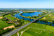 Nederland, Noord-Brabant, Den Bosch, 13-05-2019; brug in Rijksweg A2 over de Maas bij Empel met geluidsscherm in de karakteristiek huiskleur van Rijkswaterstaat. <br /> A2 motorway with bridge A2 over the Meuse at Empel. Yellow colored sound barrier.<br /> <br /> aerial photo (additional fee required); luchtfoto (toeslag op standard tarieven); copyright foto/photo Siebe Swart