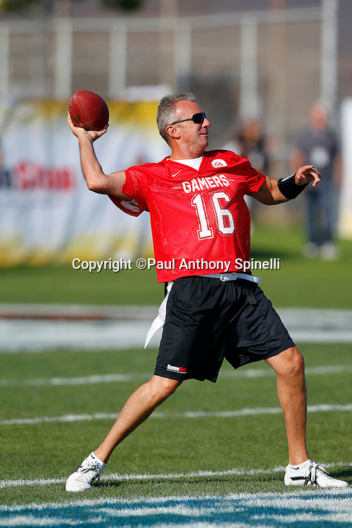 Former San Francisco 49ers quarterback Joe Montana (16) of the Gamers team throws a pass while playing flag football in the EA Sports Madden NFL 11 Launch celebrity and NFL player flag football game held at Malibu Bluffs State Park on July 22, 2010 in Malibu, California. (©Paul Anthony Spinelli)