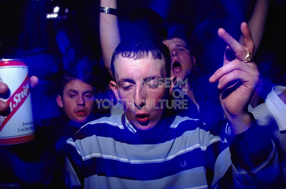 Clubbers dancing at Sugar Shack can of Red Stripe Middlesborough April 2002