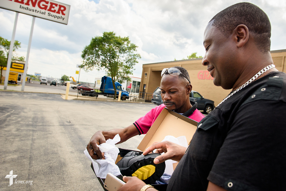 The Rev. Gui Kasongo Kabeo, pastor at Eglise Lutherienne Internationale de Sion (International Lutheran Church of Zion) and Gospel Lutheran Church, both in Milwaukee, Wis., helps Pierre, a fellow Congolese refugee, pick out and pick up shoes for his work at an an industrial supply company on Monday, Aug. 14, 2017 in Milwaukee. LCMS Communications/Erik M. Lunsford