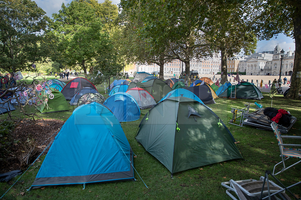 © Licensed to London News Pictures. 09/10/2019. London, UK. Extinction Rebellion activists camp out in St James's Park in sight of Horse Guards Parade as they take part in a third day of protests in central London. The climate change group intend to blockade the Westminster area for two weeks to demand that the government takes immediate and decisive action on climate change. Photo credit: Peter Macdiarmid/LNP