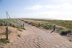 Spurn Head; East Yorkshire; showing the new road replacing the old road which has been closed due to erosion by the sea, The Humber estuary is to the right of the picture,