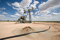 Oil wells pumping at capacity in New Mexico to supply fuel to refineries and processing plants.