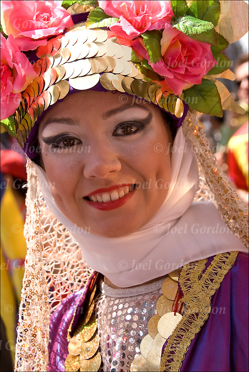 Smiling Turkish-American woman, her parents were from Izmir (western part of Turkey) in New York to before the start of the 30th Turkish Day Parade and Festival.