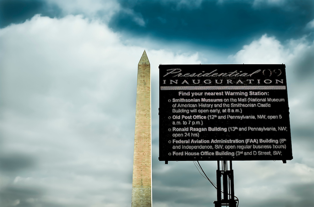 Sign on The Mall provides directions to attendees to locations offering shelter from cold at Barack Obama's inauguration in Washington D.C..  Copyright 2009 Reid McNally.
