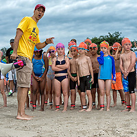 The first wave is being shown the swimming portion of the Kids in Crisis Kids Triathlon.