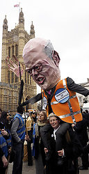 Lawyers with an effigy of Justice minister Chris Grayling during their demonstration against cuts in legal aide outside Parliament in Westminster , London, United Kingdom. Friday, 7th March 2014. Picture by Max Nash / i-Images