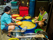 "07 FEBRUARY 2018 - BANGKOK, THAILAND:  Women in Bangkok's ""Chinatown""  sort boiled mung beans used in desserts consumed during Lunar New Year celebrations. The Lunar New Year, also called Tet or Chinese New Year, is 16 February this year. The coming year will be the Year of the Dog. Thailand has a large Chinese community and Lunar New Year is widely celebrated in Thailand, especially in Bangkok and large cities with significant Chinese communities.     PHOTO BY JACK KURTZ"