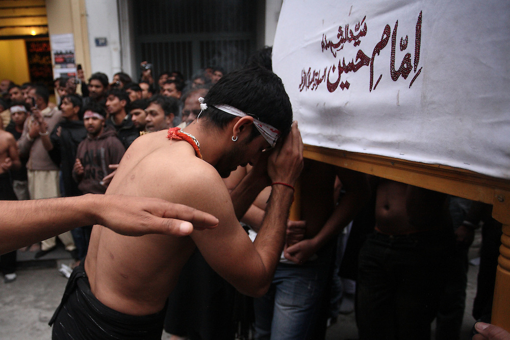 The day of Ashura, December 16th 2010. Shia Muslims in Athens are mourning in commemoration of the martyrdom of Imam Hussein, the grandson of the Prophet Muhammad, and 72 of his companions and family members in Karbala, Iraq, over 1,300 years ago while fighting for justice.