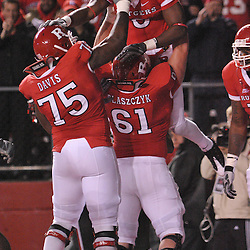 Nov 12, 2009; Piscataway, NJ, USA; Rutgers wide receiver Mohamed Sanu (6) celebrates his touchdown by being lifted into the air by center Ryan Blaszczyk (61) and offensive lineman Anthony Davis (75) during first half NCAA Big East football action between Rutgers and South Florida at  Rutgers Stadium.