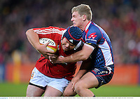 25 June 2013; Matt Stevens, British & Irish Lions, is tackled by Lachlan Mitchell, Melbourne Rebels. British & Irish Lions Tour 2013, Melbourne Rebels v British & Irish Lions. AAMI Park, Olympic Boulevard, Melbourne, Australia. Picture credit: Stephen McCarthy / SPORTSFILE