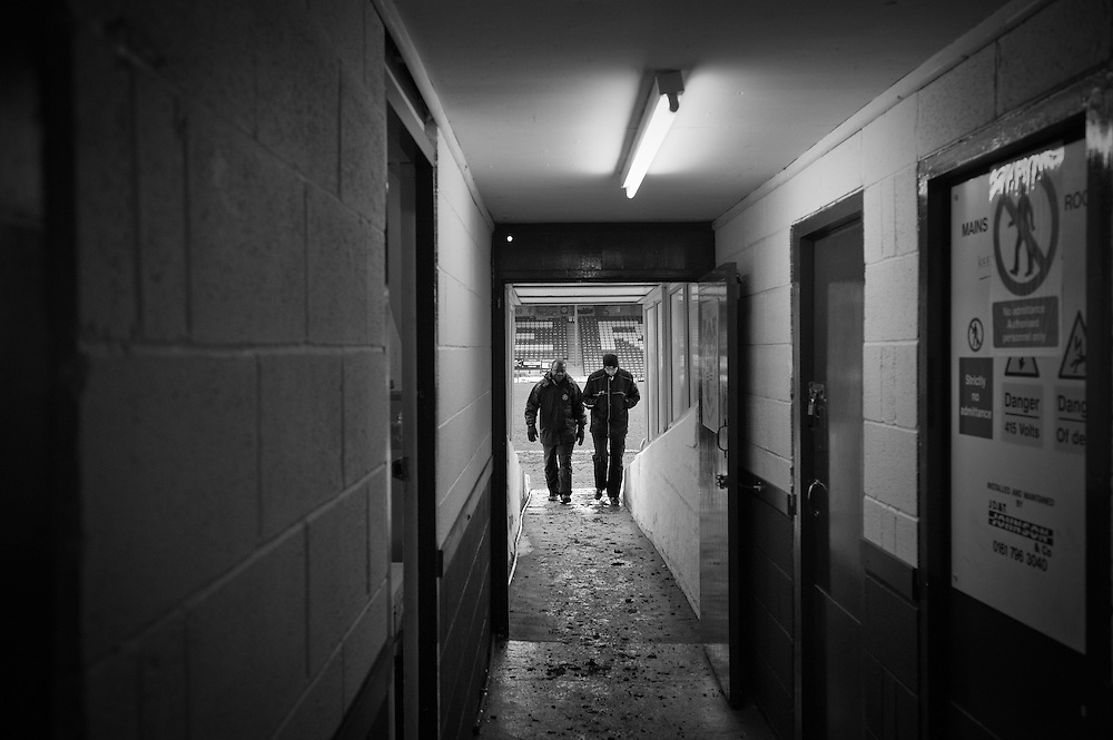 FC United of Manchester play a local team Chorley at Bury football club's ground in Lancashire, Britain. Photo shows match officials in the tunnel leading to the pitch.