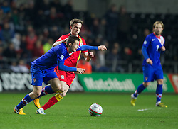 SWANSEA, WALES - Tuesday, March 26, 2013: Wales' Andy King in action against Croatia's Mateo Kovacic during the 2014 FIFA World Cup Brazil Qualifying Group A match at the Liberty Stadium. (Pic by Kieran McManus/Propaganda)