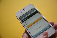 White iPhone 4s with Twitter login page on Safari browser