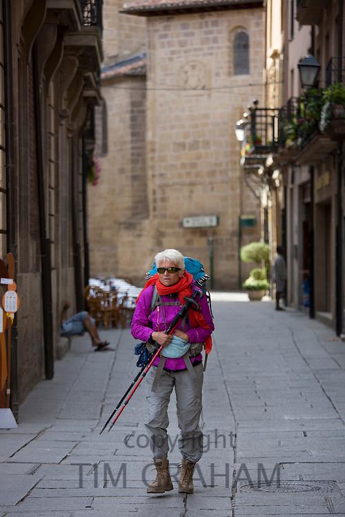 Pilgrim walker on the Camino de Santiago de Compostela route arrives in Santo Domingo de la Calzada in Castilla y Leon, Spain