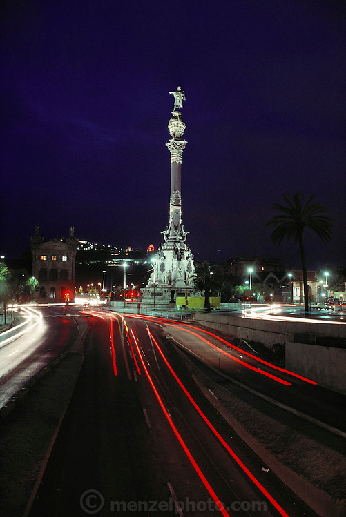 Columbus Monument with time exposure traffic red taillight trails, Barcelona, Spain.