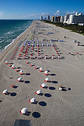 Aerial view of beach chairs and umbrellas on South Beach, view is to the south