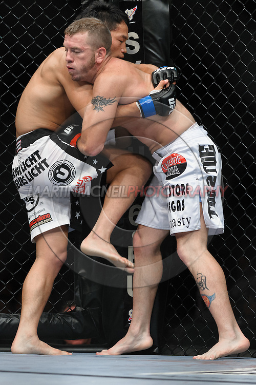 "COLOGNE, GERMANY, JUNE 13, 2009: Spencer Fisher and Caol Uno during ""UFC 99: The Comeback"" inside LanXess Arena, Cologne"