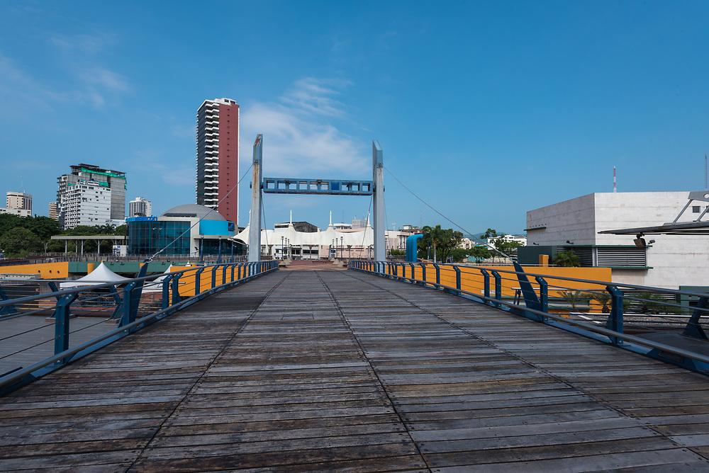 A pedestrian bridge over the Guayas river that goes into Guayaquil, Ecuador.