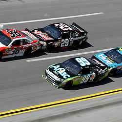 April 17, 2011; Talladega, AL, USA; NASCAR Sprint Cup Series driver Kevin Harvick (29) drafts Dave Blaney (36) and Greg Biffle (16) drafts Carl Edwards (99) during the Aarons 499 at Talladega Superspeedway.   Mandatory Credit: Derick E. Hingle