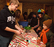 Ben Hansen, 16 of Centerville helps out in the historic Smith home in Bill Yeck Park, part of the Centerville-Washington Township Park District, Friday, December 17, 2010.  The Smith House had hot chocolate and music for those on the Holiday Stroll.