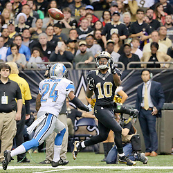 Dec 21, 2015; New Orleans, LA, USA; New Orleans Saints wide receiver Brandin Cooks (10) catches a touchdown over Detroit Lions cornerback Nevin Lawson (24) during the third quarter of a game at the Mercedes-Benz Superdome. The Lions defeated the Saints 35-27. Mandatory Credit: Derick E. Hingle-USA TODAY Sports