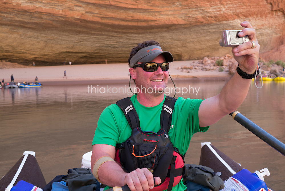 Boatman takes a selfie while rowing into Redwall Cavern, Colorado River, Grand Canyon, AZ