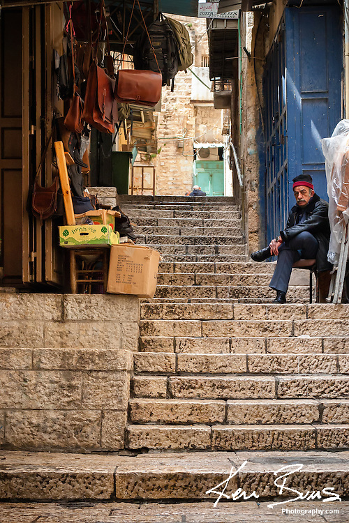 A merchant sat outside his leather bag shop waiting for tourists in the Old City of Jerusalem.