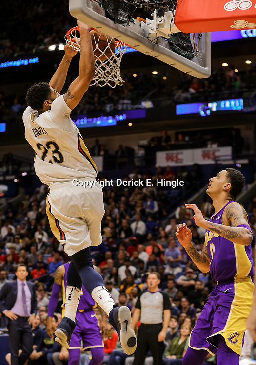 Mar 22, 2018; New Orleans, LA, USA; New Orleans Pelicans forward Anthony Davis (23) dunks over Los Angeles Lakers forward Kyle Kuzma (0) during the fourth quarter at the Smoothie King Center. The Pelicans defeated the Lakers 128-125. Mandatory Credit: Derick E. Hingle-USA TODAY Sports