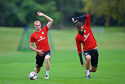 CARDIFF, WALES - Friday, September 2, 2016: Wales' Shaun MacDonald and Joe Ledley during a training session at the Vale Resort ahead of the 2018 FIFA World Cup Qualifying Group D match against Moldova. (Pic by David Rawcliffe/Propaganda)