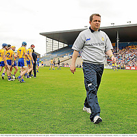 2 June 2013; Clare manager Davy Fitzgerald walks away after giving his final team talk before the game. Munster GAA Hurling Senior Championship, Quarter-Final, Clare v Waterford, Semple Stadium, Thurles, Co. Tipperary. Picture credit: Pat Murphy / SPORTSFILE