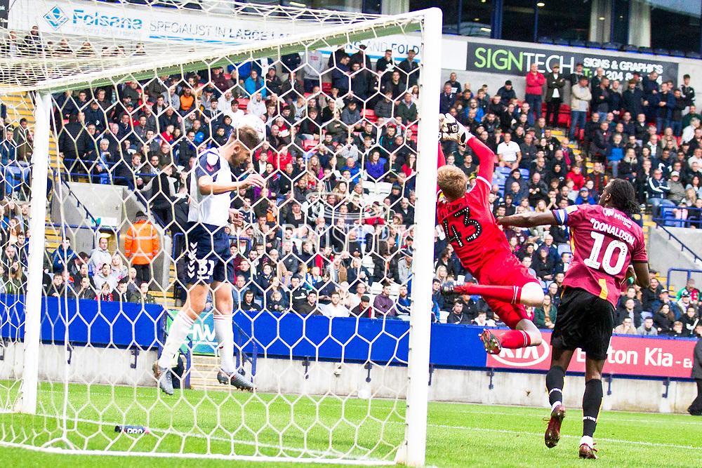 Bolton Wanderers goalkeeper Matthew Alexander makes a save during the EFL Trophy match between Bolton Wanderers and Bradford City at the University of  Bolton Stadium, Bolton, England on 3 September 2019.