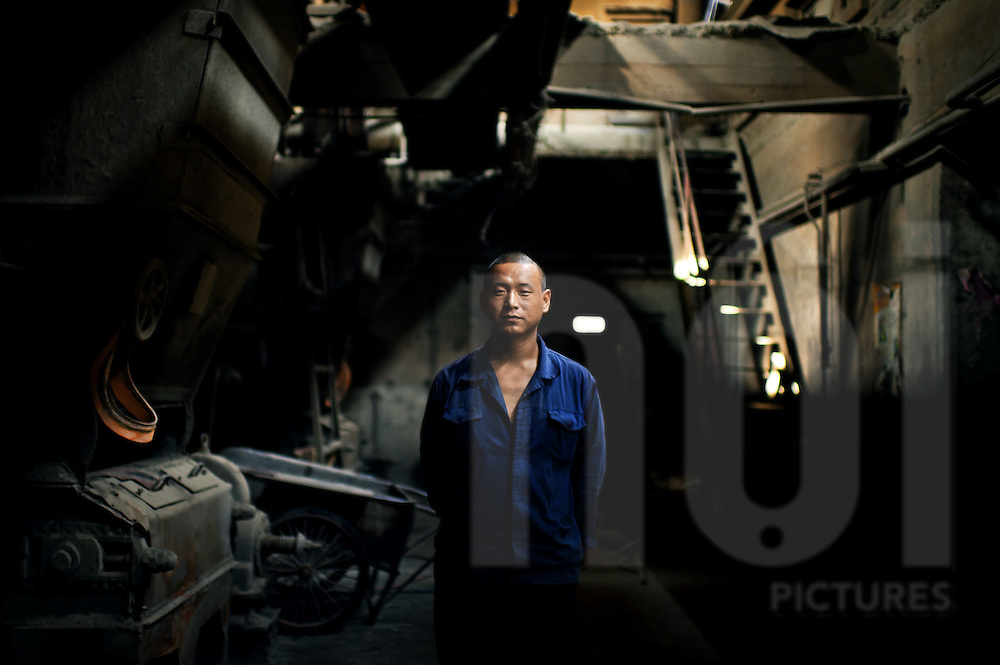Chinese worker in an old factory in Beijing, China
