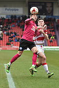Harry Beautyman (16) of Peterborough United and Harry Middleton (29) of Doncaster Rovers  during the Sky Bet League 1 match between Doncaster Rovers and Peterborough United at the Keepmoat Stadium, Doncaster, England on 19 March 2016. Photo by Ian Lyall.
