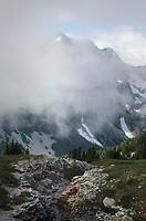 Whatcom Peak shrouded in clouds, North Cascades National Park Washington