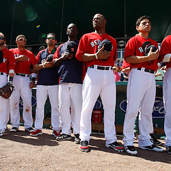 February 28, 2011; Fort Myers, FL, USA;Boston Red Sox left fielder Carl Crawford (center) and teammates stand for the national anthem before a spring training exhibition game against the Minnesota Twins at City of Palms Park.  Mandatory Credit: Derick E. Hingle-US PRESSWIRE