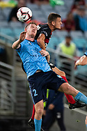Sydney FC defender Aaron Calver (2) and Western Sydney Wanderers forward Oriol Riera(9) go up for the ball at the Hyundai A-League Round 8 soccer match between Western Sydney Wanderers FC and Sydney FC at ANZ Stadium in NSW, Australia